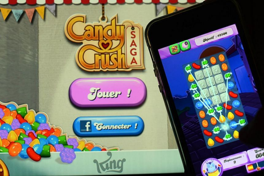King Digital Entertainment, the British developer behind the wildly-addictive mobile game Candy Crush, said on Wednesday that it could be valued at up to US$7.6 billion (S$9.6 billion) in its eagerly-awaited upcoming flotation. -- FILE PHOTO: AFP