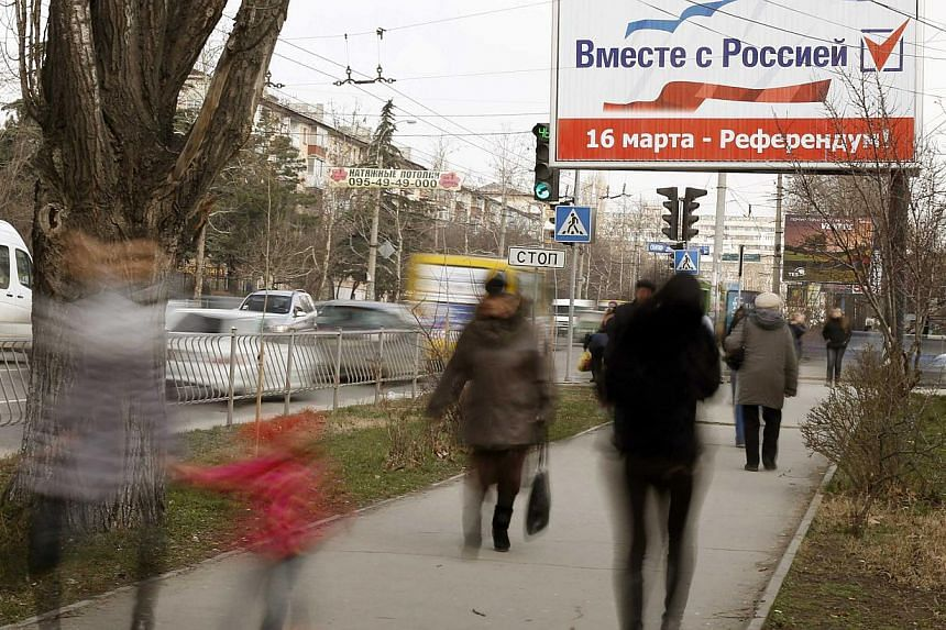 Crimea will soon take ownership of Ukrainian state companies on its territory, its first deputy prime minister said on Wednesday, pushing forward with steps to cement the region's independence before a referendum on joining Russia. -- PHOTO: REUTERS&