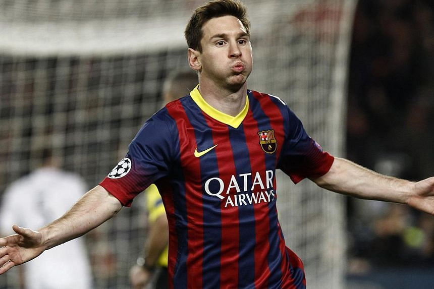 Barcelona's Argentinian forward Lionel Messi celebrates after scoring during the UEFA Champions League round of 16 second leg football match FC Barcelona vs Manchester City at the Camp Nou stadium in Barcelona on March 12, 2014. -- PHOTO: AFP