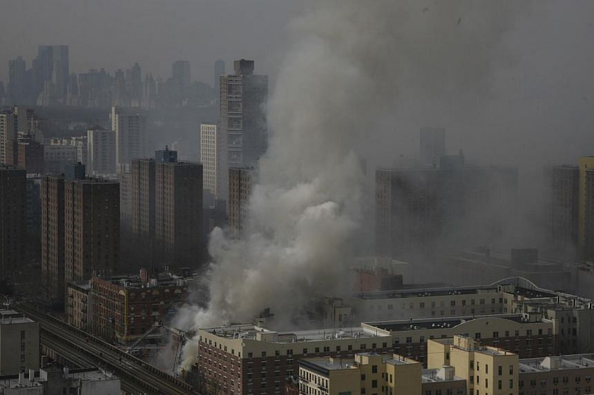 Firemen continue to spray water on the rubble at an apparent building explosion and collapse in the Harlem section of New York, in this picture provided by the New York City Mayor's Office on March 12, 2014. -- PHOTO: REUTERS