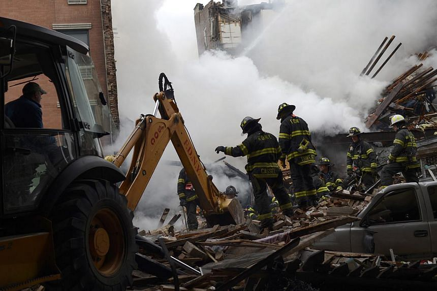 Firemen stand in the rubble at an apparent building explosion fire and collapse in the Harlem section of New York, in this picture provided by the New York City Mayor's Office on March 12, 2014. -- PHOTO: REUTERS