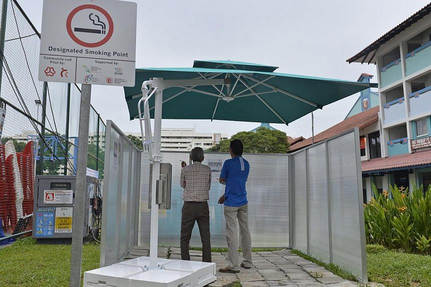 A designated smoking point between Blocks 838 and 846 in Yishun.The number of smokers caught lighting up in places where they were not supposed to more than doubled last year to 9,300 as enforcement measures were ramped up. -- ST FILE PHOTO:&nb