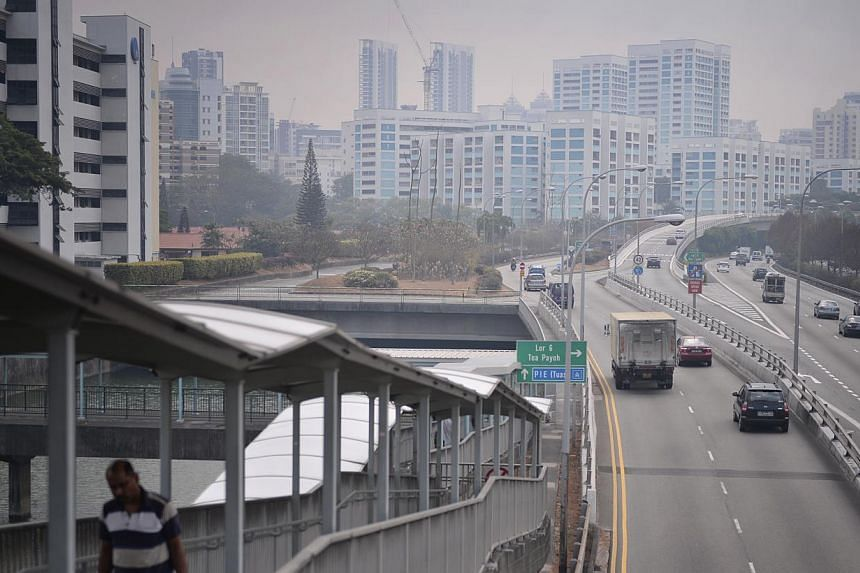A slight haze at the Central Expressway near Toa Payoh at about 4.15pm yesterday. For children with asthma, even a few minutes' exposure to high levels of PM2.5 may lead to their symptoms worsening. ST
