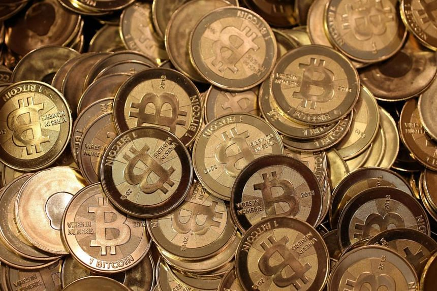 Apile of Bitcoin slugs sitting in a box ready to be minted on April 26, 2013 in Sandy, Utah. Authorities in Singapore are taking the first step in setting up rules regarding virtual currencies such as bitcoins. -- FILE PHOTO: AFP