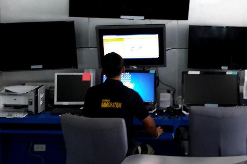 An employee working at thePattaya Immigration DepartmentTransnational Crime Database, which keeps an eye on those coming and going.-- ST PHOTO: NIRMAL GHOSH