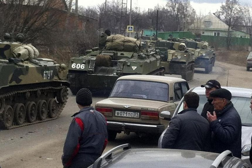 Russian light infantry fighting vehicles drive along roads in the west Russian town of Vesyolaya Lopan about 20km from the Ukrainian border on March 12, 2014. Russia said on Thursday, March 13, 2014, it was stepping up field training for tank, a