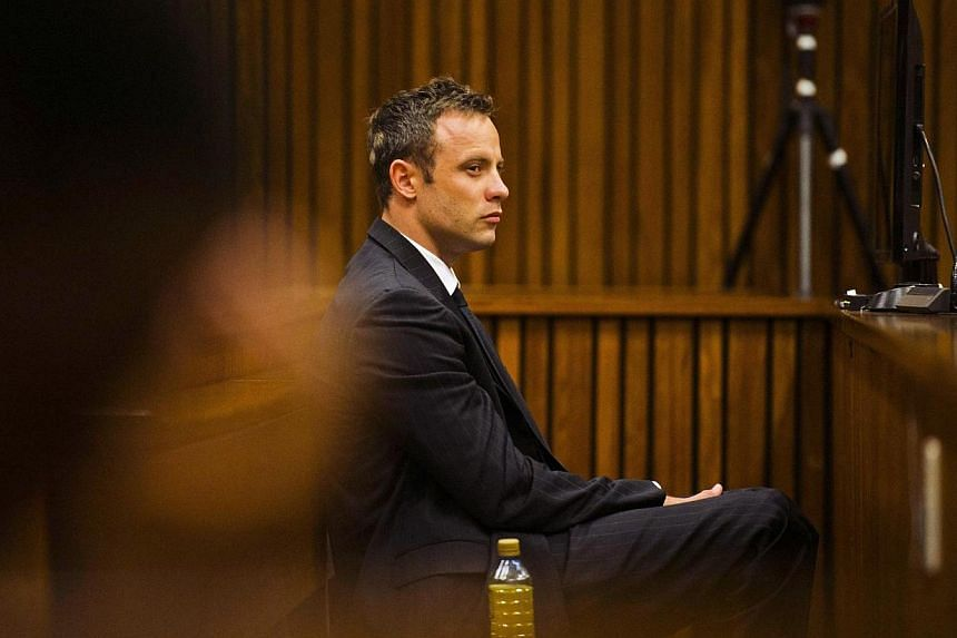Olympic and Paralympic track star Oscar Pistorius sits in the dock during court proceedings at the North Gauteng High Court in Pretoria, March 13, 2014. Preparations have been made to allow Oscar Pistorius's murder trial to sit two weeks longer than