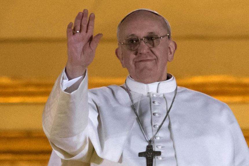 Argentina's Jorge Bergoglio, elected Pope Francis I waves from the window of St Peter's Basilica's balcony after being elected the 266th pope of the Roman Catholic Church on March 13, 2013 at the Vatican. Pope Francis on Thursday, March 13, 2014&nbsp