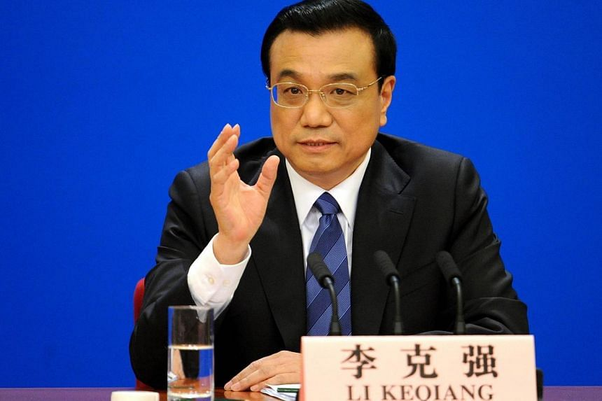 """Chinese Premier Li Keqiang speaks at a press conference at the Great Hall of the People in Beijing on March 13, 2014. China and its neighbours are capable of producing """"sounds of harmony"""" instead of """"jarring noises"""", if all sides observe mutual respe"""