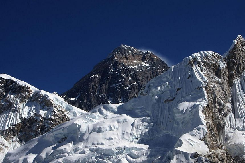 """Nepalese climbing specialists will fix a second rope at the Hillary Step, a dangerous """"death zone"""" bottleneck near the Mount Everest summit, to ease congestion on the world's highest mountain, a hiking group said on Thursday, March 13, 2014. -- FILE"""
