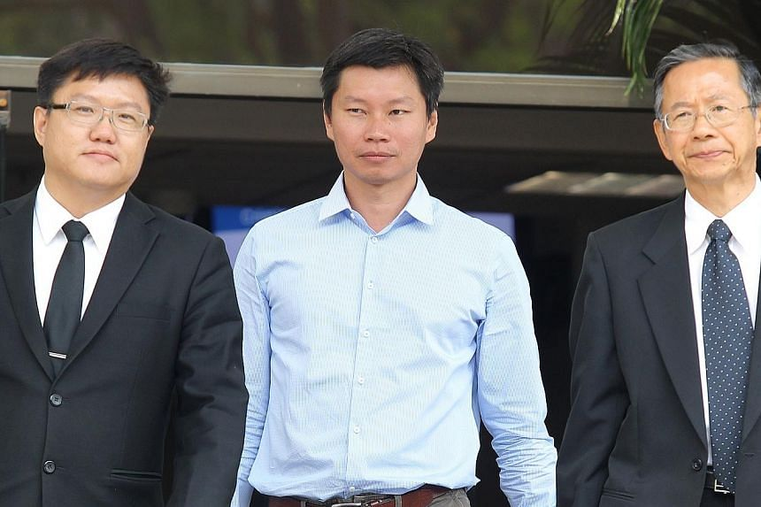 Trial of Bernard Lim (centre), a National Parks Board officer who oversaw the purchase of 256 Brompton bicycles photographd on March 13, 2014, at the State Courts.The National Parks Board (NParks) officer who oversaw the $57,200 purchase of 26