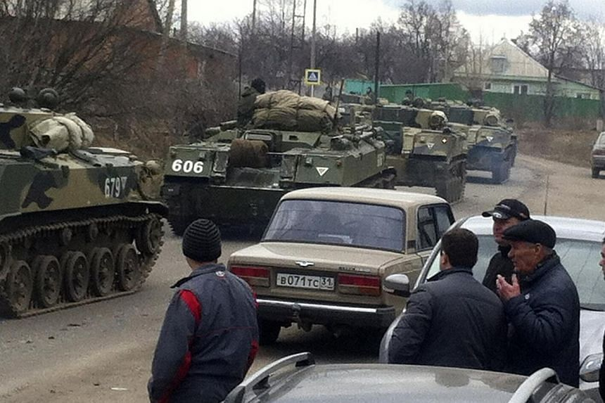 Russian light infantry fighting vehicles drive along roads in the west Russian town of Vesyolaya Lopan about 20 km from the Ukrainian border, on March 12, 2014. A senior Russian lawmaker said military units are occupying positions in Crimea