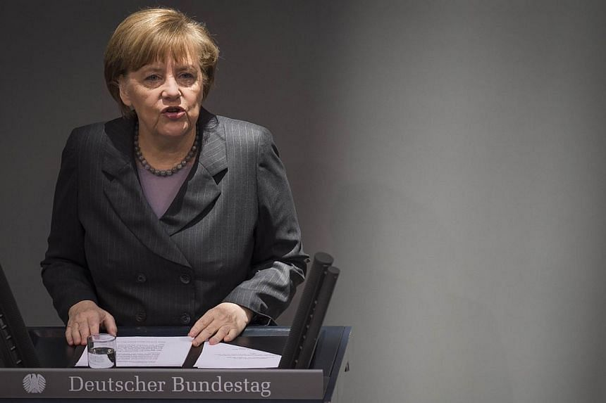 """German Chancellor Angela Merkel lays out her governments policy on Ukraine by addressing delegates at the Bundestag, Germany's Lower House of Parliament in Berlin, on March 13, 2014. DrMerkel said on Thursday that Russia risked """"massive"""" politi"""