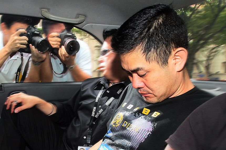 Lim Wee Thong was charged with the murder of Ms Loh Nyuk Moi. A junior prison officer who murdered one of his four girlfriends will now spend the rest of his life behind bars.-- NP FILE PHOTO:KELVIN CHNG