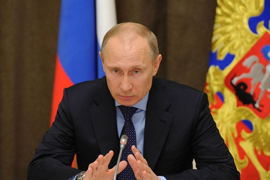 President Vladimir Putin said on Thursday, March 13, 2014, that Russia was not to blame for the crisis over Ukraine's Crimea region. -- PHOTO: AFP