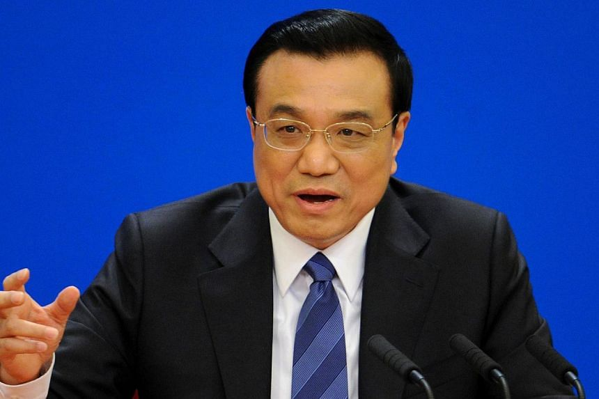"""Chinese Premier Li Keqiang speaks at a press conference at the Great Hall of the People in Beijing on March 13, 2014.Li Keqiang said on Thursday that Beijing has """"zero tolerance"""" for corruption however senior the culprit, as the country's leade"""