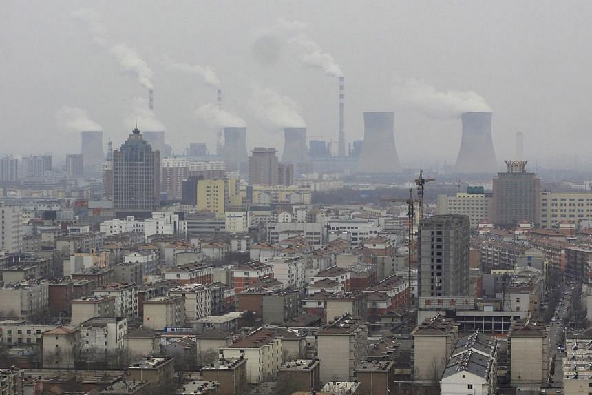 Smoke rises from chimneys on a hazy day in Dezhou, Shandong province on March 12, 2014. Japanese electronics giant Panasonic said on Thursday, March 13, 2014, it would give employees sent to China a wage premium to compensate for the country's h