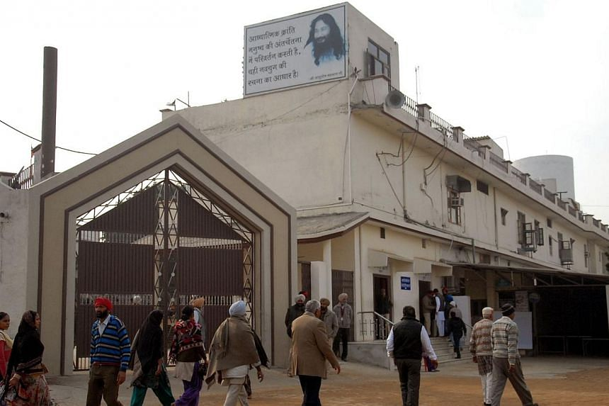 In this photo taken on Jan 29, 2014, followers of Indian spiritual leader Ashutosh Maharaj gather outside the Divya Jyoti Jagrati Sansthan in Nurmahal on the outskirts of Jalandhar, after his death. AnIndian guru declared dead has been in a dee