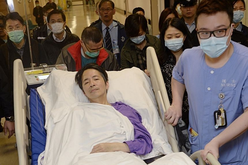 Ming Pao's former chief editor Kevin Lau, who was brutally attacked on Wednesday, Feb 26, 2014, is transferred to a private ward in Eastern Hospital after spending three days in intensive care in Hong Kong on March 1, 2014.Hong Kong police on T