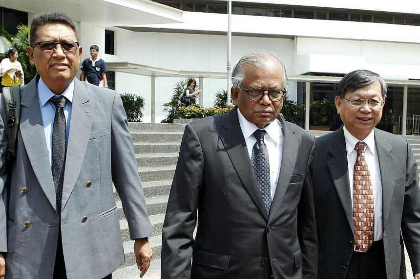 Former president of the Singapore National Trades Union Congress (NTUC) John De Payva (left), former Supreme Court judge G. Pannir Selvam (centre) and chairman of the West Coast Citizens Consultative Committee Andrew Chua (right) leaving the State Co