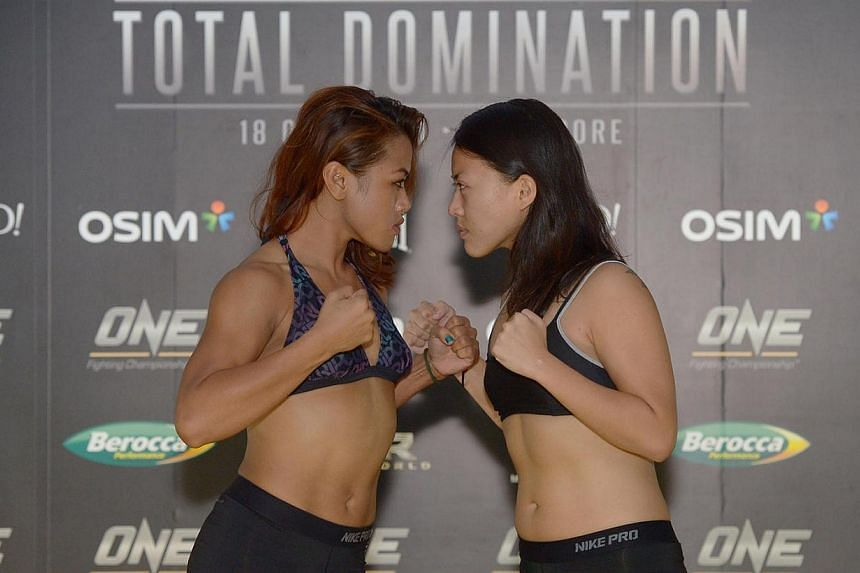 Malaysia's Ann Osman (left) and Singapore's Sherilyn Lim are both promising a knockout in ONE Fighting Championship's (ONE FC) second all-woman mix martial arts event at the Singapore Indoor Stadium on Thursday, March 13, 2014.THE much-anti