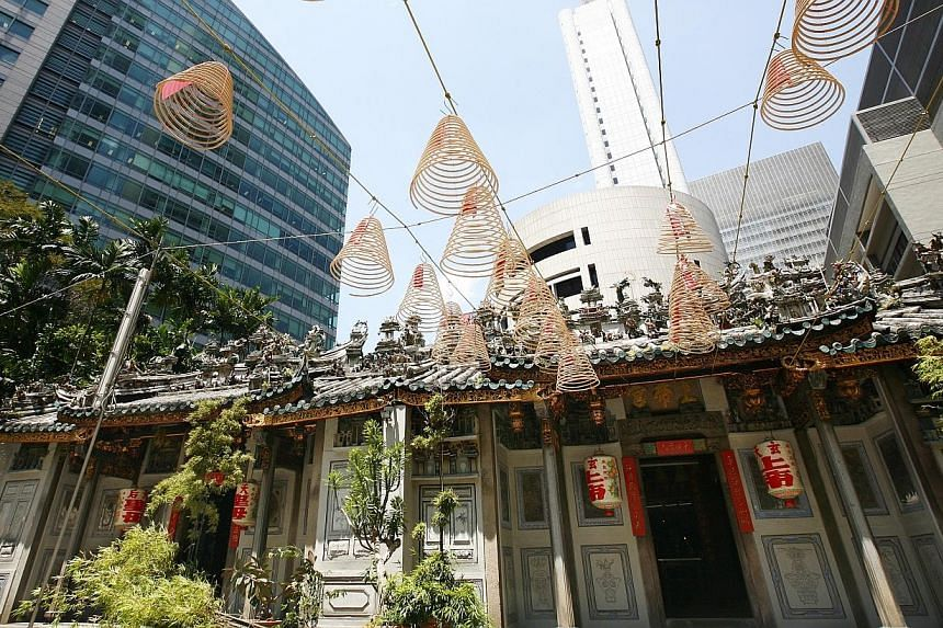 The Yueh Hai Ching temple on Phillip Street in 2010. The temple,which has been given a $7.5-million makeover, is one of a handful of century-old places of worship in Singapore.-- PHOTOS: ST FILE, BERITA HARIAN,NATIONAL MUSEUM OF SIN