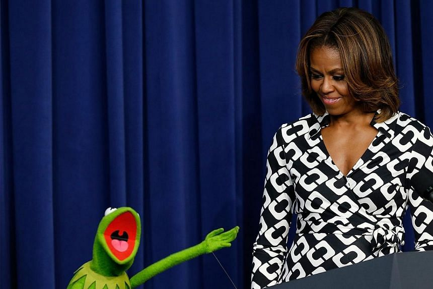 Kermit the Frog is welcomed by US First Lady Michelle Obama at a screening of Disney's Muppets Most Wanted at the Eisenhower Executive Office Building on March 12, 2014, in Washington, DC. The movie preview was for an audience of military children an