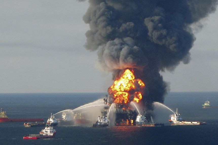 Fire boat response crews battle the blazing remnants of the offshore oil rig Deepwater Horizon, off Louisiana on April 21, 2010. The US Environmental Protection Agency announced on Thursday an end to its ban on BP obtaining government contracts follo