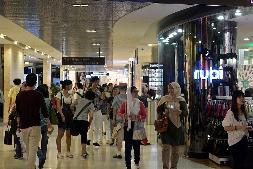 Shoppers at basement two of Ion Orchard shopping mall on March 15, 2013. Shoppers in Singapore were freer with their money in January, according to the latest data released by the Singapore Department of Statistics on Friday. -- ST FILE PHOTO: RAJ NA