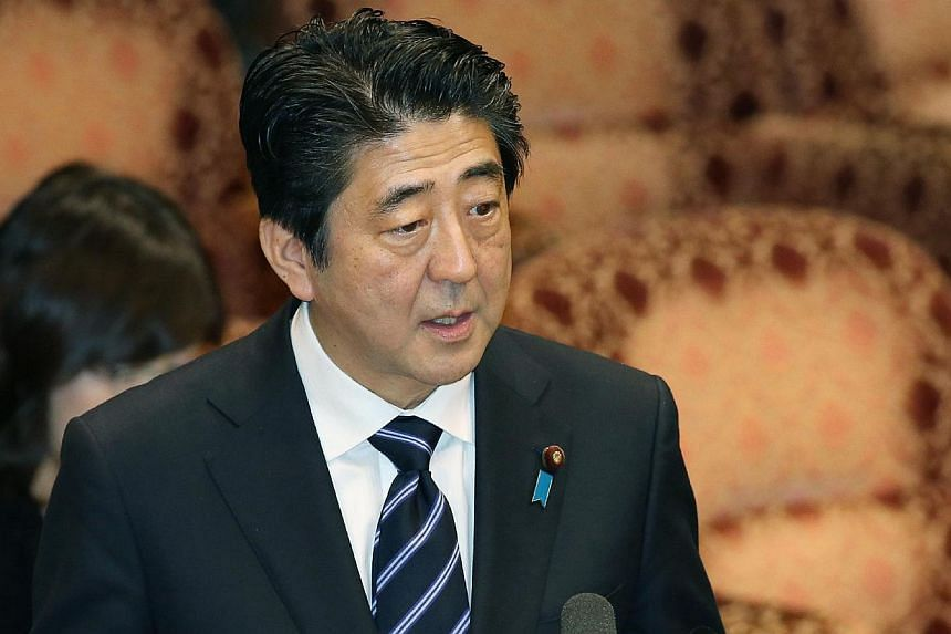Japanese Prime Minister Shinzo Abe said on Friday, March 14, 2014, that his government would not revise a landmark 1993 apology to women, many Korean, forced to serve in wartime military brothels, as Washington presses for better ties between its two