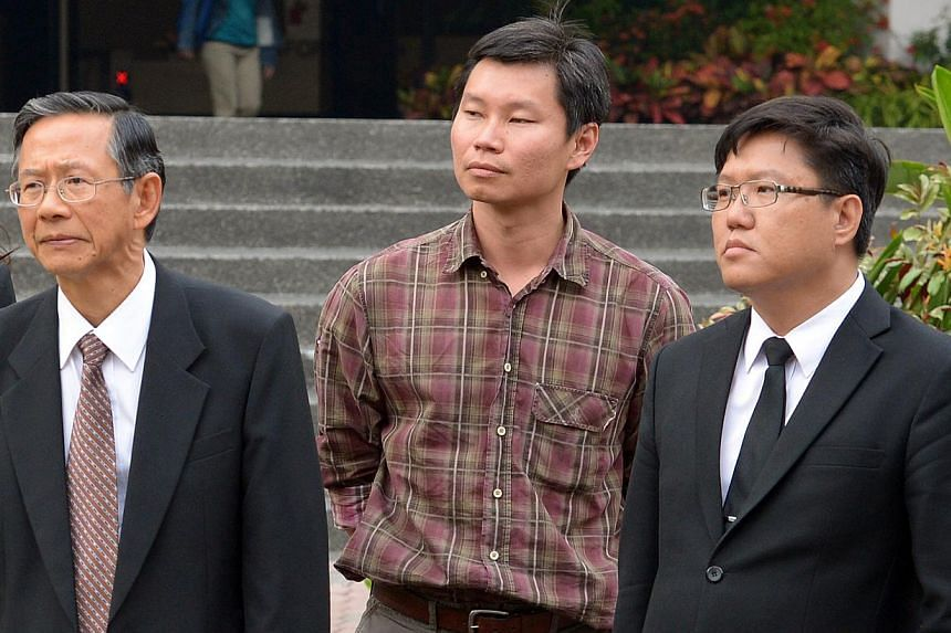 """National Parks Board officer Bernard Lim Yong Soon (centre), who isaccused of lying to auditors, was led to believe he was having an informal """"chit-chat"""" with them when in fact it was an official interview, a court heard on Friday.-- ST P"""