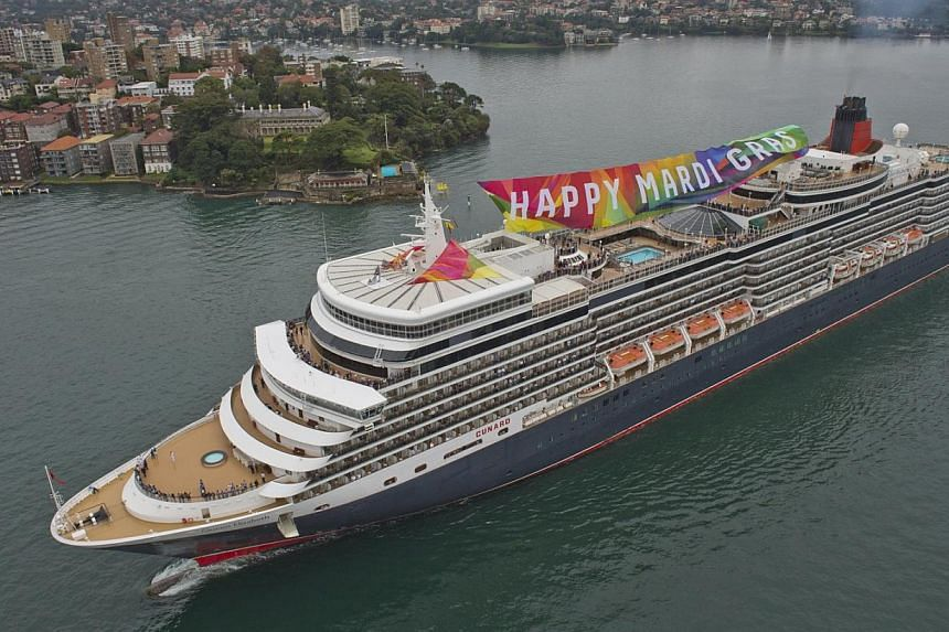A giant rainbow banner wishing a happy Mardi Gras is unfurled atop the ocean liner Queen Elizabeth as it steams into Sydney Harbour, March 1, 2014.Growing acceptance and legalisation of same-sex marriages in the United States and around the glo