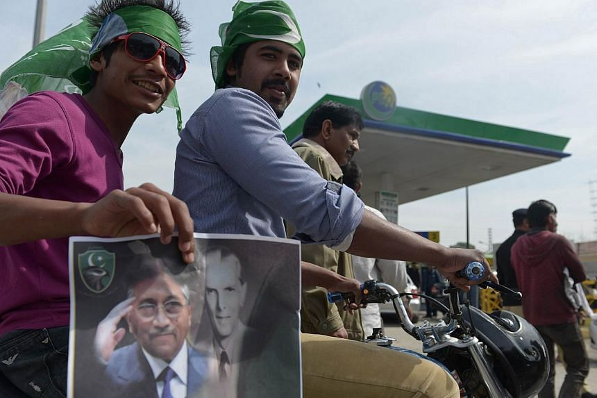 Supporters of Pakistan's former military ruler Pervez Musharraf gather outside the Armed Forces Institute of Cardiology, where Musharraf is currently being treated, in Rawalpindi, on March 14, 2014. A special tribunal hearing a landmark treason case