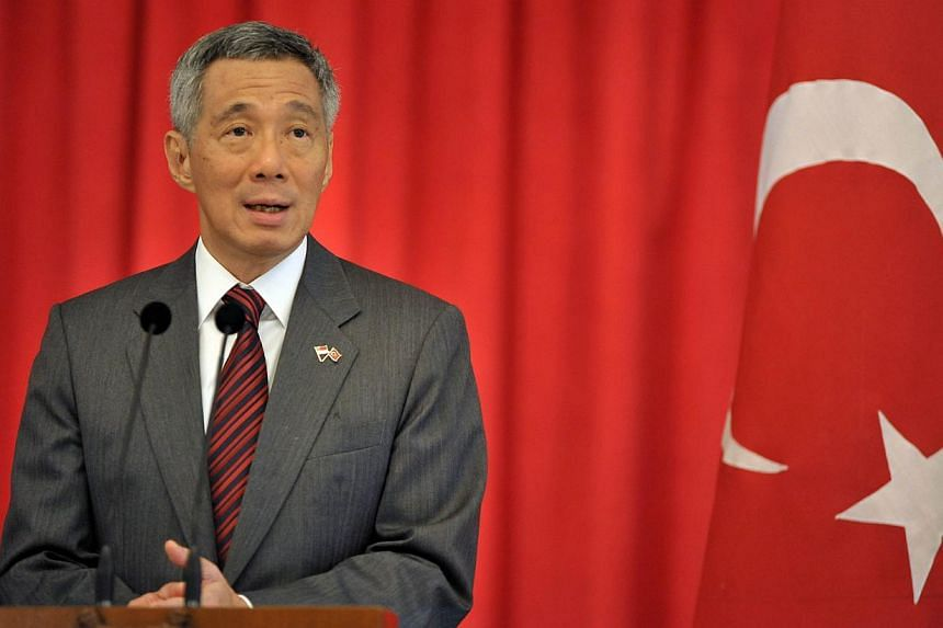 Prime Minister Lee Hsien Loong wrote to his Malaysian counterpart Najib Razak and China's Premier Li Keqiang on Friday, March 14, 2014, to express solidarity and offer support, as the search for a missing Malaysian Airlines flight continued. -- FILE