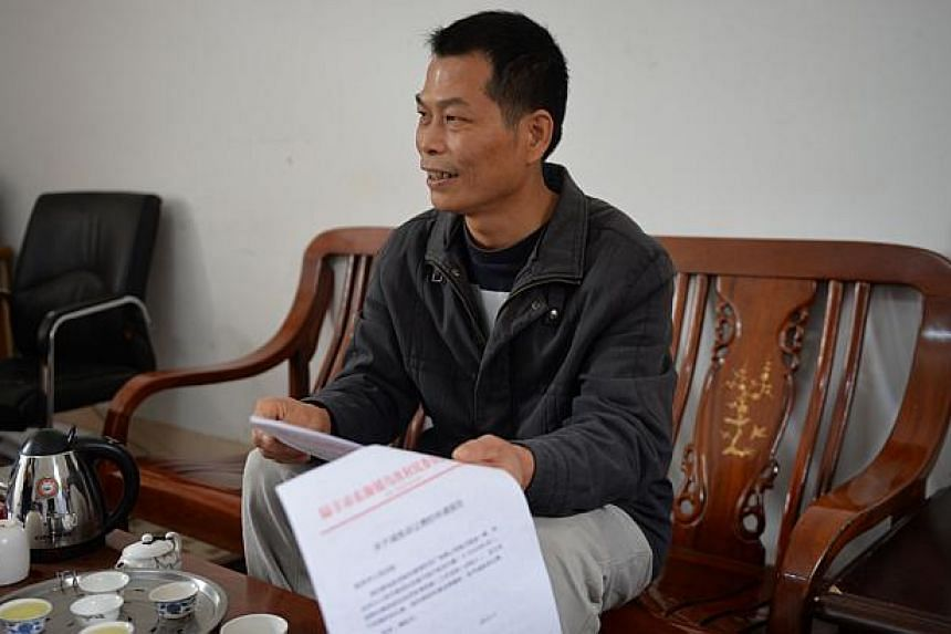 This photo taken on Dec 12, 2013, shows elected village official Yang Semao talking to AFP in the southern Chinese village of Wukan in Guangdong province.Chinese police have detained on bribery charges the deputy chief of a village that attract