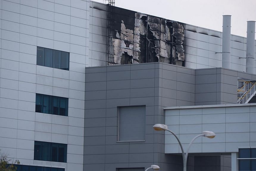 A fire took place on Friday morning at the Tuas manufacturing plant of Norway-headquartered solar energy firm REC. -- ST PHOTO: DESMOND LIM