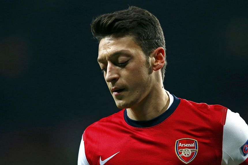 Arsenal's Mesut Oezil reacts after missing a penalty against Bayern Munich during their Champions League round of 16 first leg soccer match at the Emirates Stadium in London on Feb 19, 2014.Oezil will be out for between three and six weeks, man