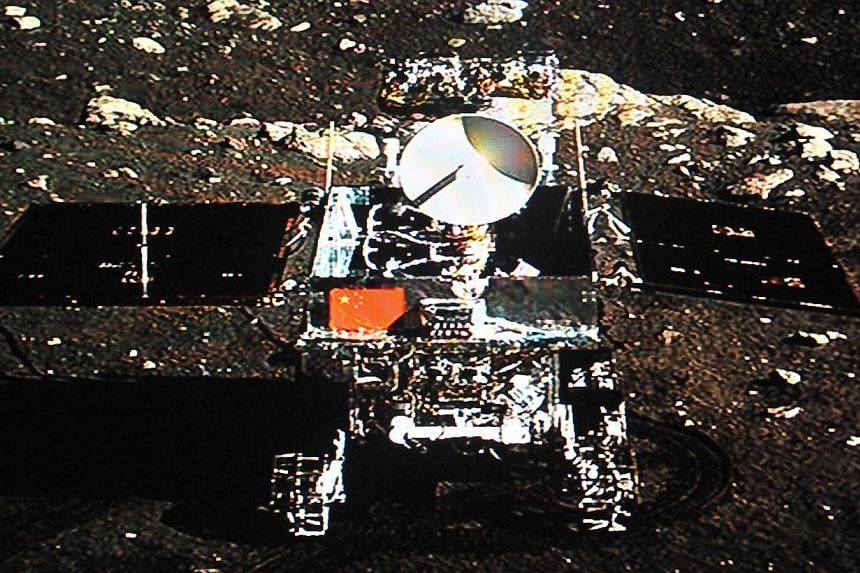 """China's Jade Rabbit lunar rover taken by the Chang'e-3 probe lander on Dec 15, 2013.China's troubled Jade Rabbit moon rover """"woke up"""" again early on Friday, March 14, 2014, though the mechanical troubles that have plagued it remain unfixed, the"""