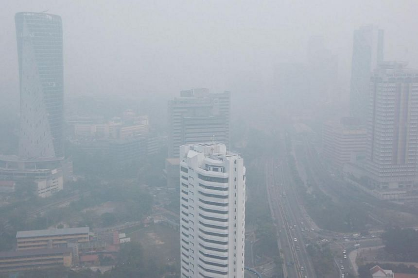 Haze in Kuala Lumpur. It's likely to be a hazy weekend, as winds from the north-east blow smoke from hotspots in peninsular Malaysia.  -- PHOTO: SIN CHEW DAILY PUBLICATION