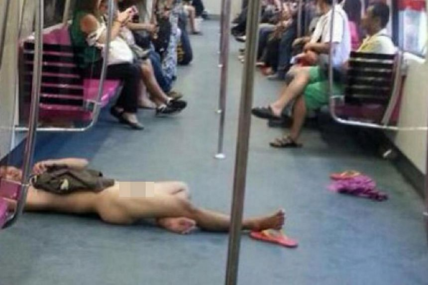 A man who stripped naked on an MRT train on Thursday, March 13, 2014, has been arrested by the police. -- PHOTO: ANG GUAN WEI