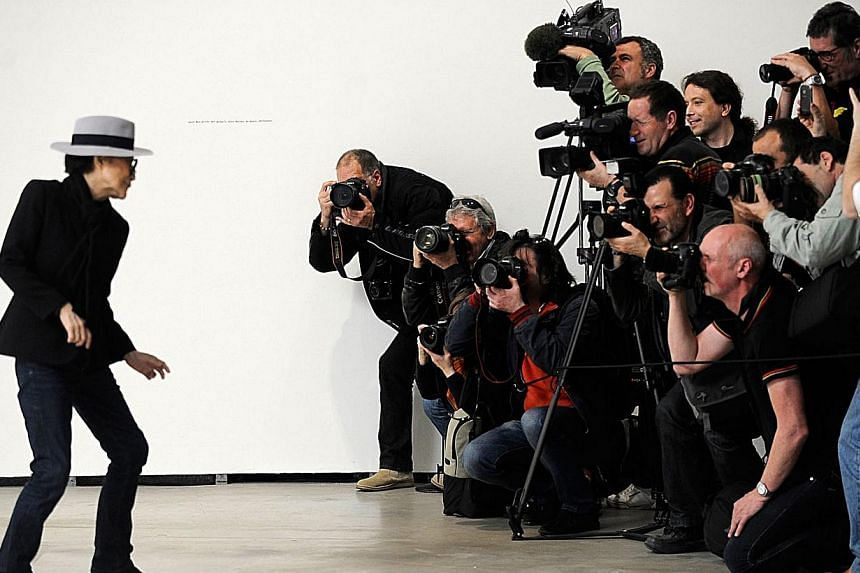 Japanese artist Yoko Ono (left) poses for photographers during the presentation of her exhibition Yoko Ono. Half-A-Wind-Show - A Retrospective at the Guggenheim Bilbao Museum in the northern Spanish Basque city of Bilbao on March 13, 2014. -- PHOTO: