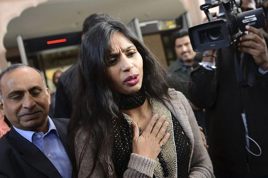 Indian diplomat Devyani Khobragade leaves with her father Uttam Khobragade (left) from the Maharashtra Sadan state guesthouse to meet India's Foreign Minister Salman Khurshid in New Delhi in January. -- PHOTO: REUTERS