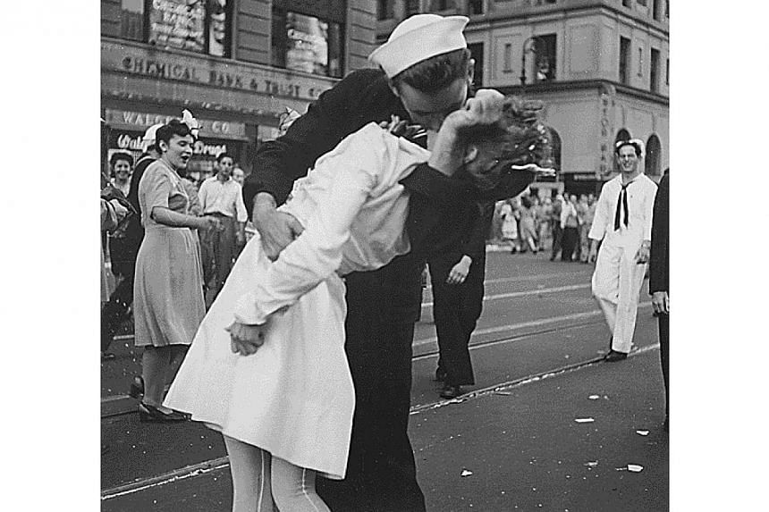 US Navy sailor Glenn Edward McDuffie (left) kisses a nurse in Times Square in an impromptu moment at the close of World War Two, after the surrender of Japan was announced in New York on August 14, 1945. Mr McDuffie died this month at the age of 86.