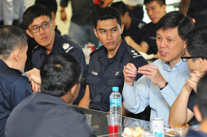 Members of the Committee to Strengthen National Service, which includes Minister for Social and Family Development and Second Minister for Defence Chan Chun Sing (in light blue shirt), having lunch with NSFs and NSmen from the various Singapore Civil