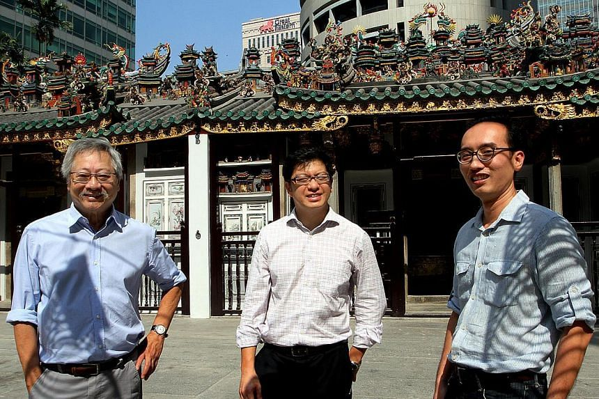ABOVE: Architect Raymond Woo (from left), Mr Jamie Teo, chairman of the restoration subcommittee, and Dr Yeo Kang Shua, architectural conservator, at the restored temple.  RIGHT: A view of the temple exterior taken in 2010, before restoration work be