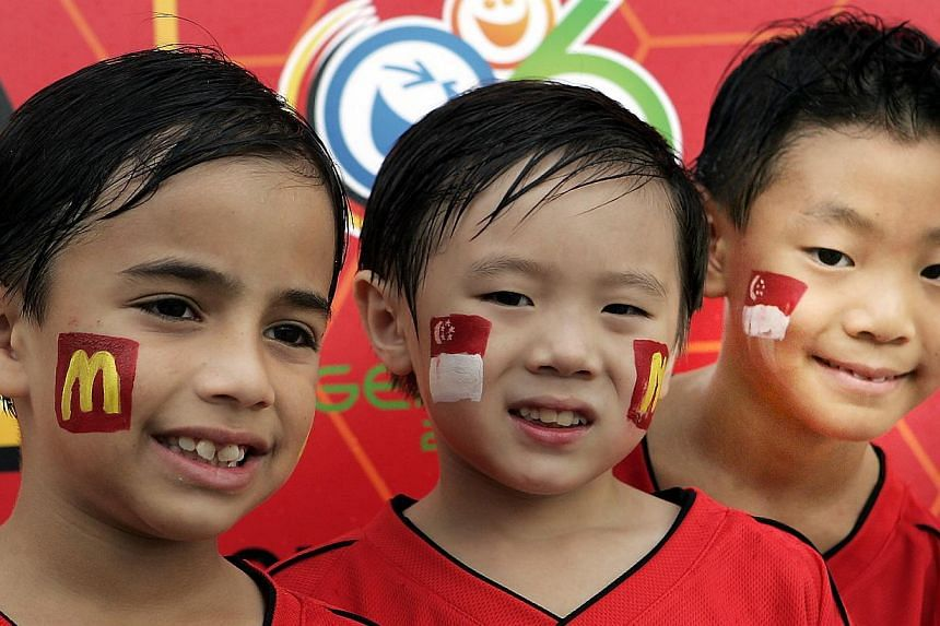 (From left) Luke David Levy, Danyon Christian Tay and Colin Oon won trips to the 2006 World Cup thanks to ST's partnership with McDonald's.