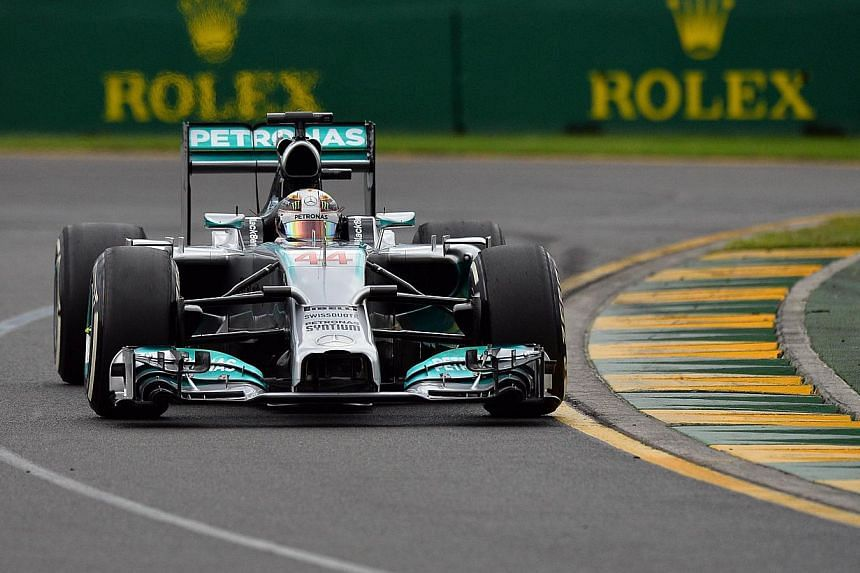 Mercedes driver Lewis Hamilton of Britain takes a corner during the qualifying session of the Formula One Australian Grand Prix in Melbourne, on March 15, 2014. Hamilton captured pole position for Mercedes for the season-opening Australian Grand Prix