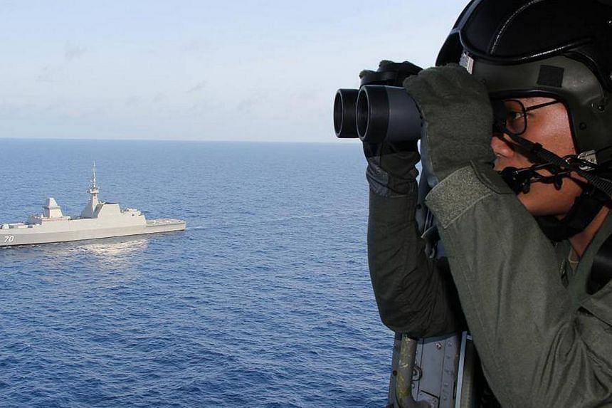 Republic of Singapore Navypersonnel participating in the search and rescue operations in the South China Sea for the missing Malaysia Airlines flight MH370, on March 13, 2014. -- FILE PHOTO: AFP/REPUBLIC OF SINGAPORE NAVY