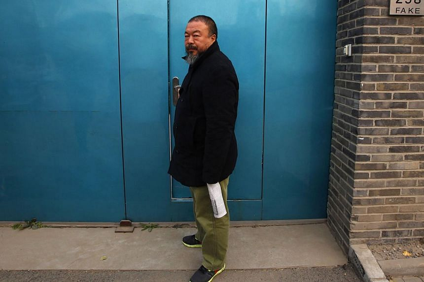 Dissident Chinese artist Ai Weiwei has said he hopes President Xi Jinping makes time to see his exhibition during the leader's visit to Germany this month, in an interview published on Saturday, March 15, 2014. -- FILE PHOTO: REUTERS