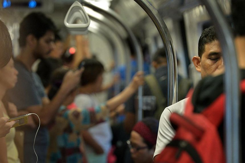 Freelance writer Charlotte Ashton said that she felt let down after her experience when she had felt nauseous on an MRT train but had to crouch for 15 minutes because no one offered her a seat. -- ST PHOTO: KUA CHEE SIONG